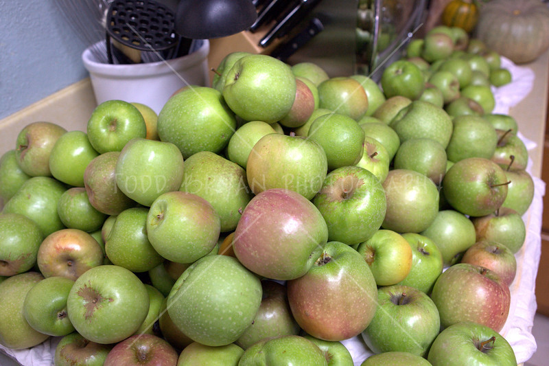 Huge stack of green Granny Smith apples awaits processing and canning