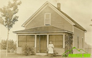 My great great grandmother poses in front of her South Dakota farmhouse in 1916.